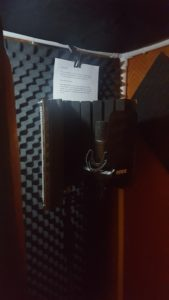 Voiceover sound booth with the lights off.